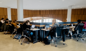 tables around ledge with students studying