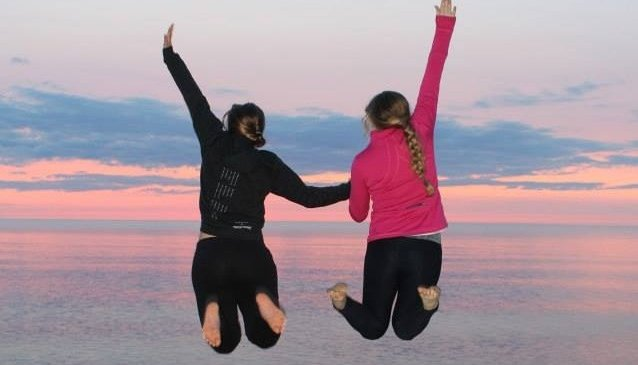 Two Women Jumping for Joy