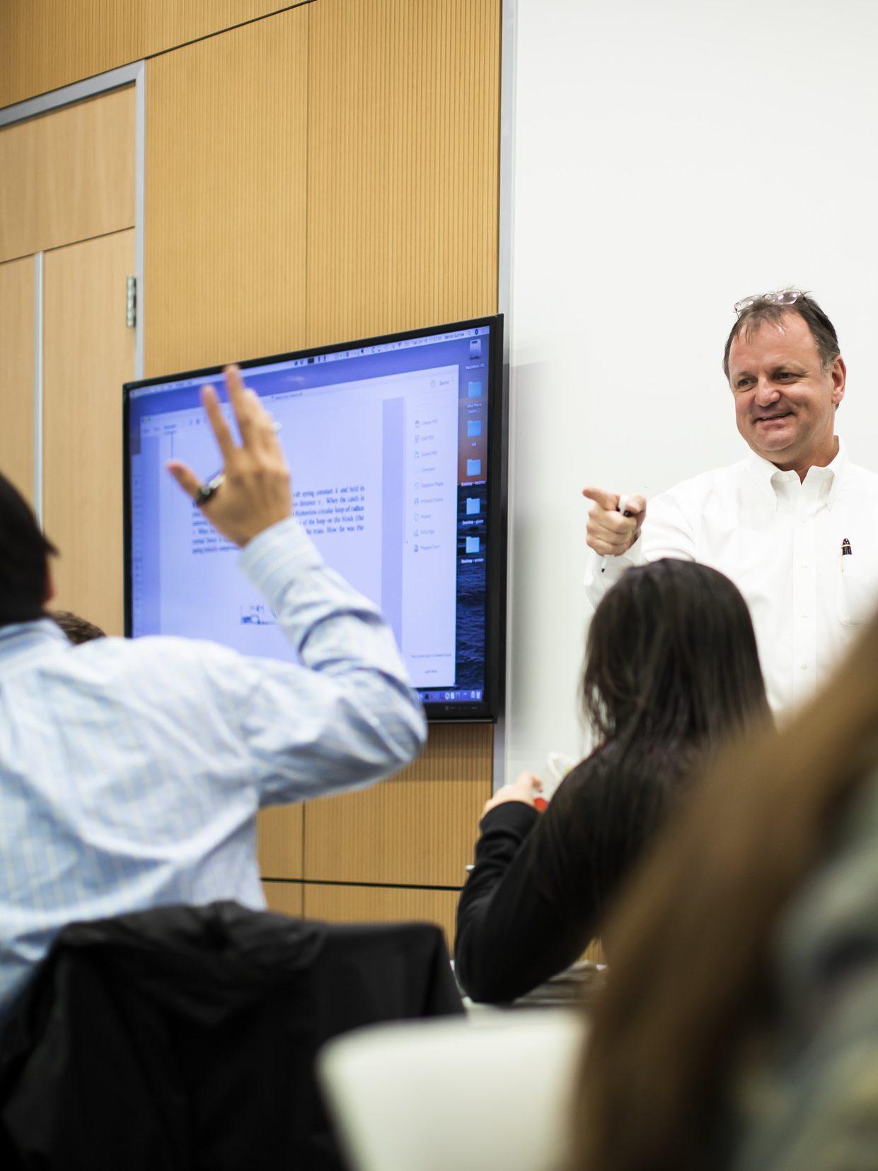 Professor Bernd Surrow conducting class in a SERC classroom