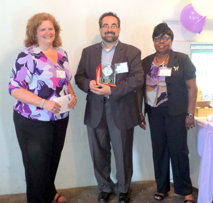 SWCDC Executive Director Donna Henry, presents CRP Assistant Professor Jeffrey Doshna the Community Partner Award
