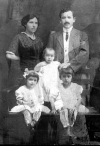 An immigrant couple and their children., circa 1910