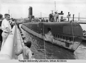 Submarine docking at marina