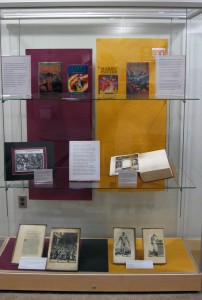 display case picture shows books and images from historic text