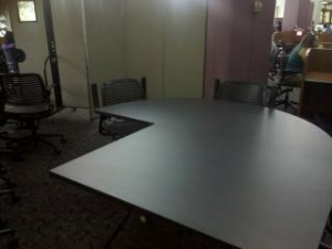 Larger surface area table in study room.
