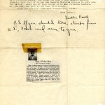 Page two of a typed letter on yellowed paper with a newspaper clipping affixed with cellophane tape.