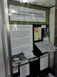 Glass display case in library with texts and photos for the Alternative American Poetry exhibition (links to larger version).