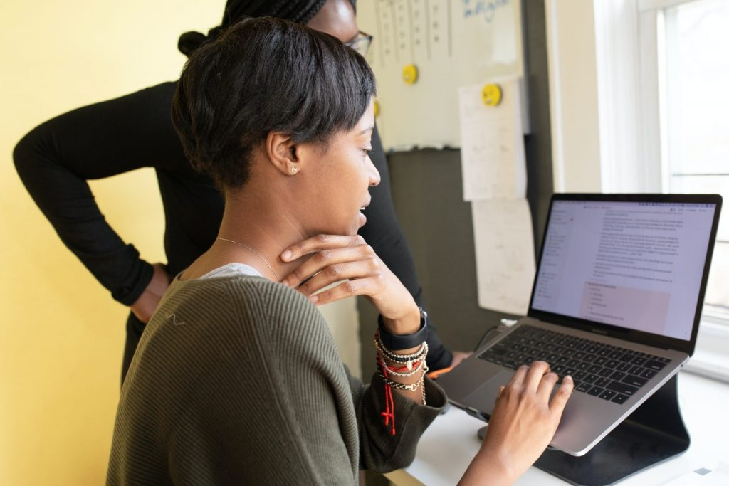 Photograph of woman in office looking at computer