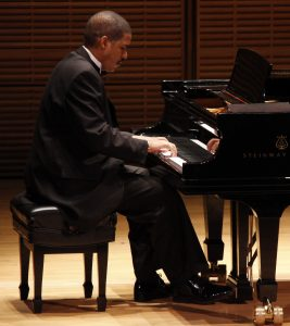 Photo of Dr. Fluellen playing the piano.