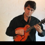 Gabe Locati playing mandolin