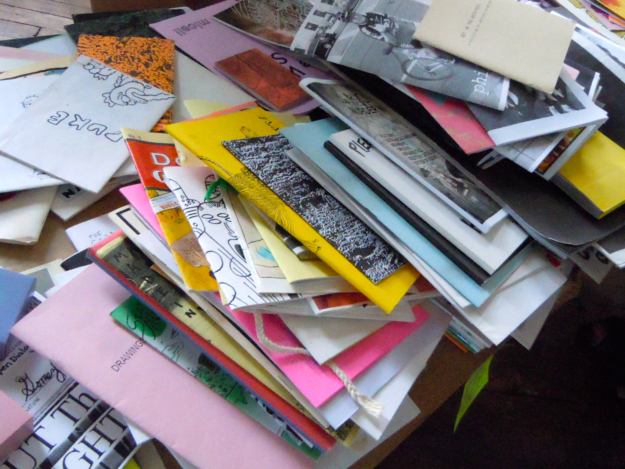 Stacks of zines.